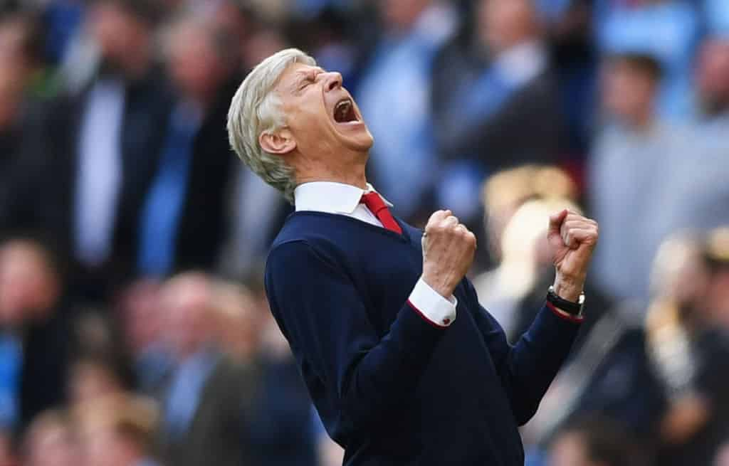 Arsene Wenger celebrates v Manchester City
