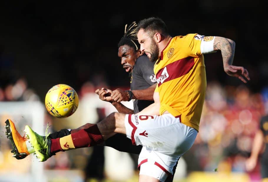 MOTHERWELL, SCOTLAND - OCTOBER 06: Peter Hartley of Motherwell vies with Dolly Menga of Livingston during the Ladbrokes Scottish Premiership match between Motherwell and Livingston at Fir Park Stadium on October 6, 2018 in Motherwell, Scotland. (Photo by Ian MacNicol/Getty Images)