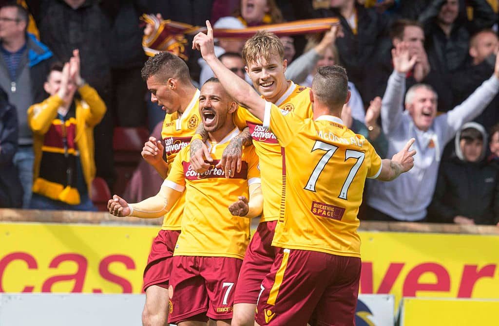 MOTHERWELL, SCOTLAND - MAY 31: Lionel Ainsworth (2L) of Motherwell celebrates his goal making it 2:0 with team mates during the Scottish Premiership play-off final 2nd leg between Motherwell and Rangers at Fir Park on May 31, 2015 in Motherwell, Scotland. (Photo by Jeff Holmes/Getty Images)