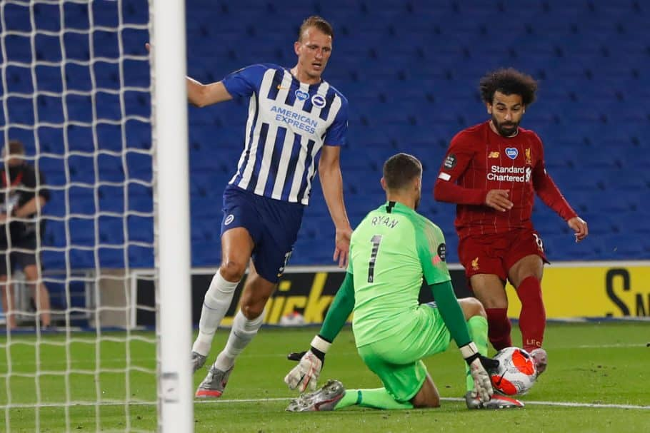 Matt Ryan blocks an attempt by Liverpool's Mohamed Salah (R) Brighton's Australian goalkeeper Mathew Ryan during the English Premier League football match between Brighton and Hove Albion and Liverpool at the American Express Community Stadium in Brighton, southern England on July 8, 2020. (Photo by PAUL CHILDS / POOL / AFP) / RESTRICTED TO EDITORIAL USE./AFP via Getty Images)
