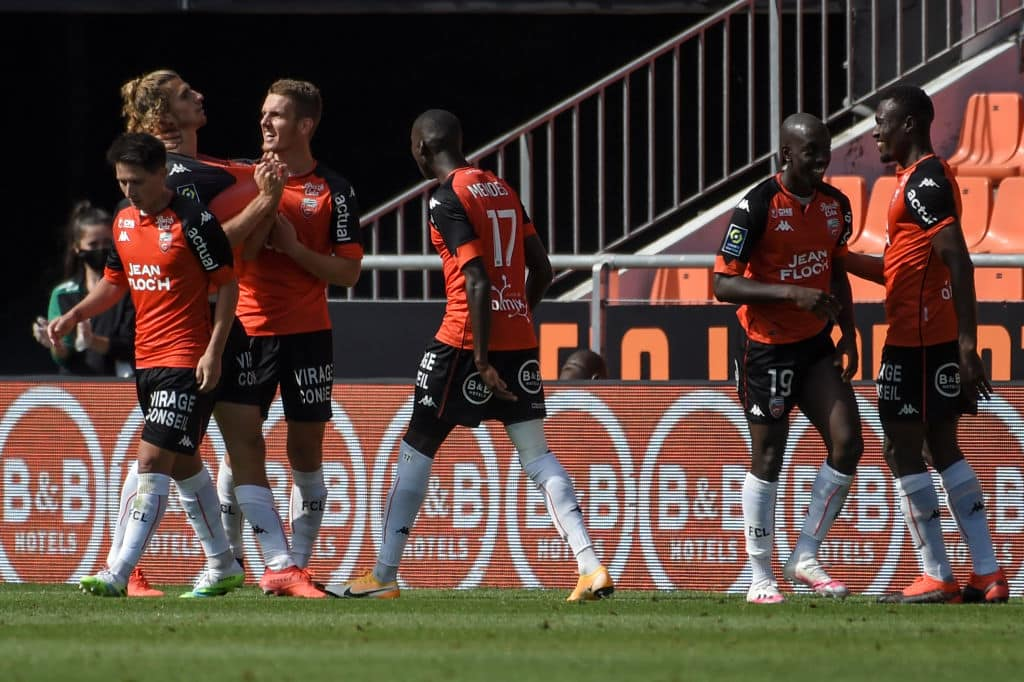 Lorient's players celebrate a goal by French forward Pierre-Yves Hamel (2nd L) during the L1 football match between Lorient (FC Lorient ) and Strasbourg (RCSA) at at Le Moustoir Stadium in Lorient, western France on August 23, 2020. (Photo by Sebastien SALOM-GOMIS / AFP) (Photo by SEBASTIEN SALOM-GOMIS/AFP via Getty Images)