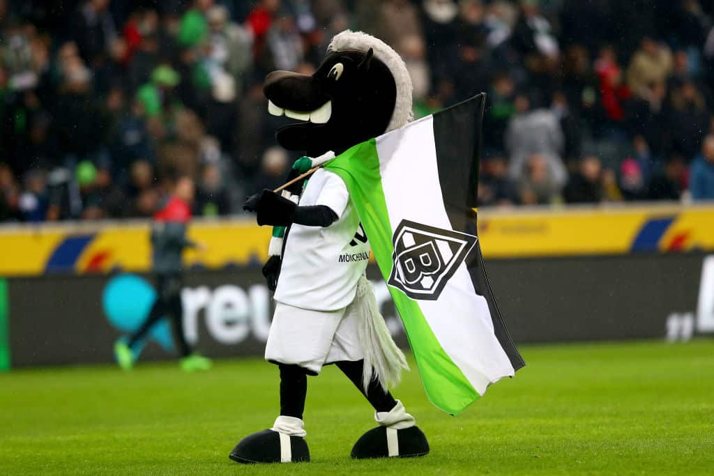 MOENCHENGLADBACH, GERMANY - FEBRUARY 04: Mascot Juenter of Moenchengladbach waves a flag during the Bundesliga match between Borussia Moenchengladbach and SC Freiburg at Borussia-Park on February 4, 2017 in Moenchengladbach, Germany. (Photo by Christof Koepsel/Bongarts/Getty Images)