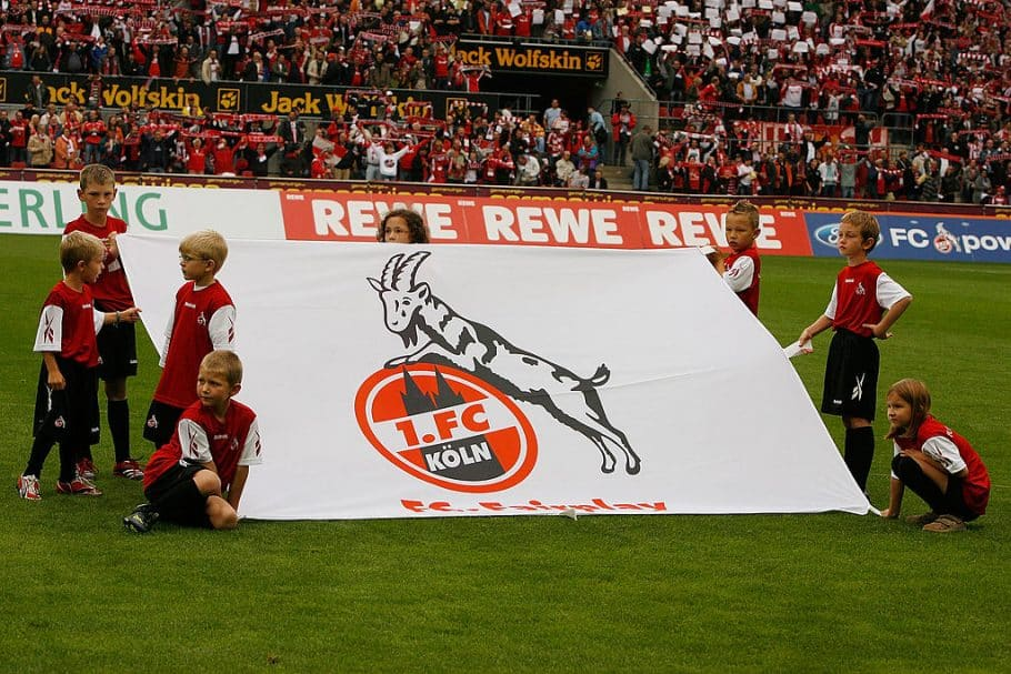 COLOGNE, GERMANY - SEPTEMBER 13: Children holding a flag of Koeln on the pitch prior the Bundesliga match between 1. FC Koeln and Bayern Muenchen at the RheinEnergie stadium on September 13, 2008 in Cologne, Germany (Photo by Thomas Niedermueller/Bongarts/Getty Images)