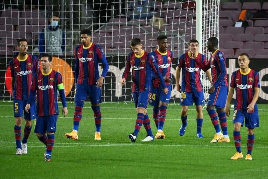 Barcelona's Spanish midfielder Pedri (3R) celebrates teammates after scoring during the UEFA Champions League football match between FC Barcelona and Ferencvarosi TC at the Camp Nou stadium in Barcelona on October 20, 2020. (Photo by LLUIS GENE / AFP) (Photo by LLUIS GENE/AFP via Getty Images)