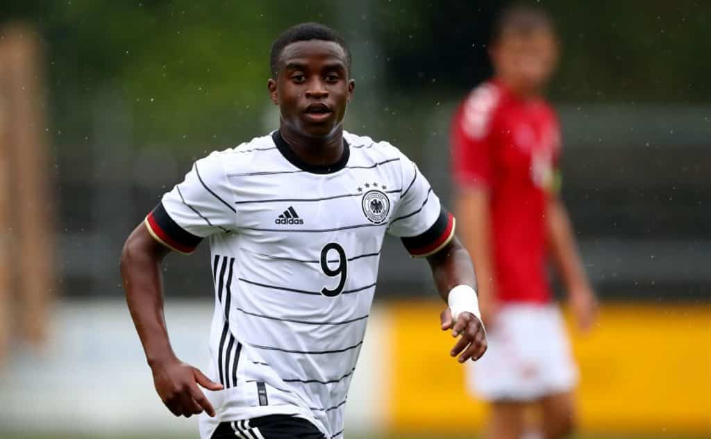 NORDERSTEDT, GERMANY - SEPTEMBER 03: Youssoufa Moukoko of Germany gestures during the international friendly match between Germany U20 and Denmark U20 at Edmund-Plambeck-Stadion on September 03, 2020 in Norderstedt, Germany. (Photo by Martin Rose/Getty Images)