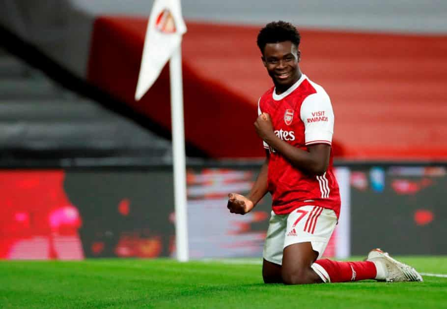 LONDON, ENGLAND - DECEMBER 26: Arsenal's Bukayo Saka celebrates after scoring his team's third goal during the Premier League match between Arsenal and Chelsea at Emirates Stadium on December 26, 2020 in London, England.  The match will be played without fans, behind closed doors as a Covid-19 precautionary measure.  (Photo by Andrew Boyers - Pool / Getty Images)