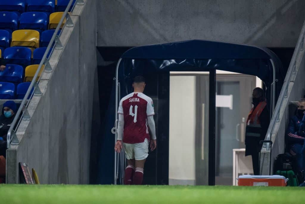 WIMBLEDON, ENGLAND - DECEMBER 08: William Saliba of Arsenal U21 walks off from pitch after receiving red card during the EFL Trophy match between AFC Wimbledon and Arsenal U21 at Plough Lane on December 8, 2020 in Wimbledon, England. (Photo by Sebastian Frej/MB Media/Getty Images)