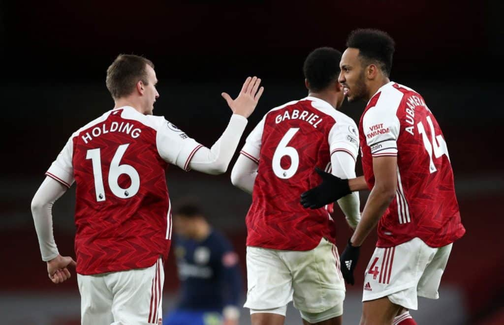 LONDON, ENGLAND - DECEMBER 16: Pierre-Emerick Aubameyang of Arsenal celebrates with teammate Rob Holding after scoring their team's first goal during the Premier League match between Arsenal and Southampton at Emirates Stadium on December 16, 2020 in London, England. The match will be played without fans, behind closed doors as a Covid-19 precaution. (Photo by Peter Cziborra - Pool/Getty Images)