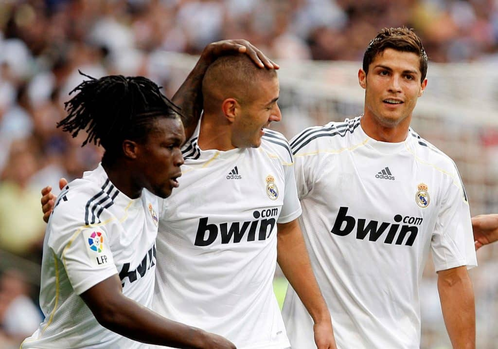 MADRID, SPAIN - SEPTEMBER 26: Karim Benzema (C) of Real Madrid celebrates his goal with Royston Drenthe (L) and Cristiano Ronaldo (R) during the La Liga match between Real Madrid and Tenerife at Estadio Santiago Bernabeu on September 26, 2009 in Madrid, Spain. (Photo by Elisa Estrada/Real Madrid via Getty Images)