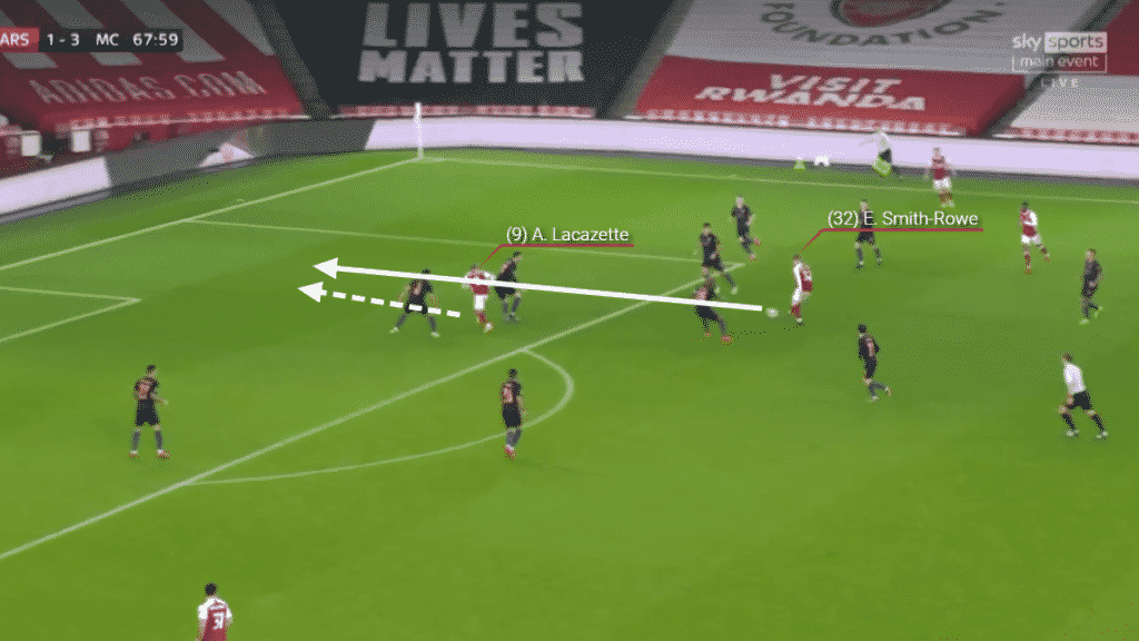 Spinning with the ball, Smith-Rowe plays and Incisive pass in to Alexandre Lacazette.