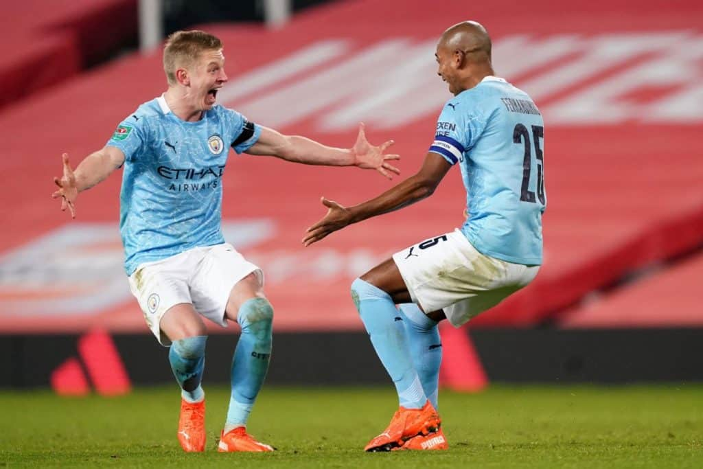 MANCHESTER, ENGLAND - JANUARY 06: Oleksandr Zinchencko of Manchester City celebrates with Fernandinho of Manchester City after Fernandinho scores his sides 2nd goal during the Carabao Cup Semi Final match between Manchester United and Manchester City at Old Trafford on January 06, 2021 in Manchester, England. The match will be played without fans, behind closed doors as a Covid-19 precaution. (Photo by Matt McNulty - Manchester City/Manchester City FC via Getty Images)