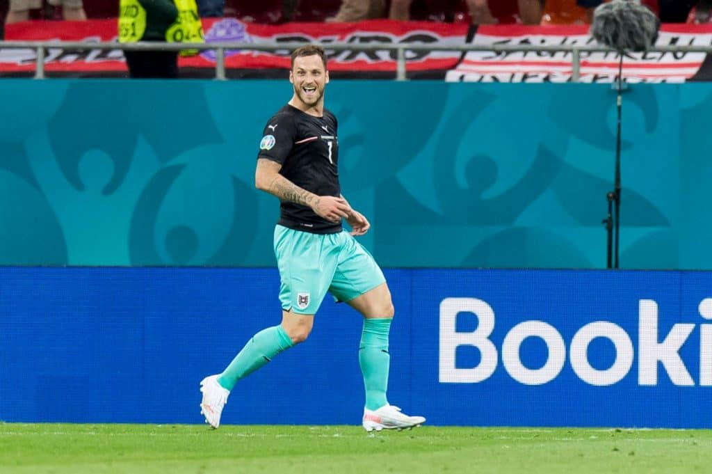 BUCHAREST, ROMANIA - JUNE 13: (BILD ZEITUNG OUT) Marko Arnautovic of Austria celebrates after scoring his team's third goal during the UEFA Euro 2020 Championship Group C match between Austria and North Macedonia at National Arena on June 13, 2021 in Bucharest, Romania. (Photo by Cristi Preda/DeFodi Images via Getty Images)