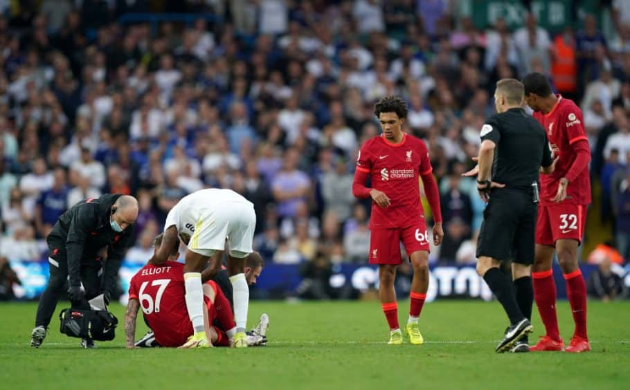 Liverpool's Harvey Elliott disagrees with the decision to keep Leeds defender Pascal Struijk's red card for challenging him